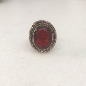Jewelry - Metal cocktail ring with large red stone